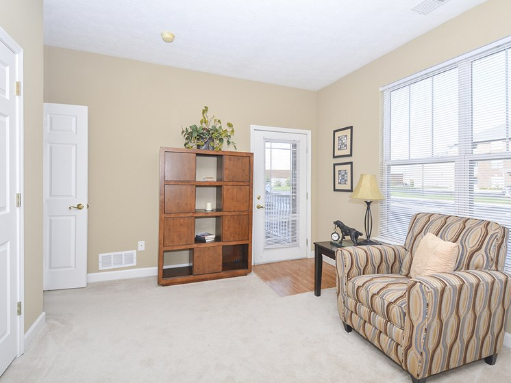Bedroom with Large Windows and Balcony Access