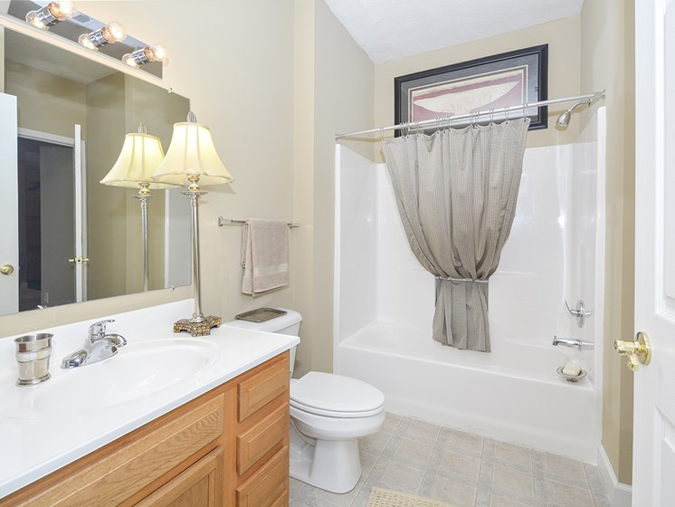 Full Sized Bathroom with Tile Style Flooring and Large Vanity