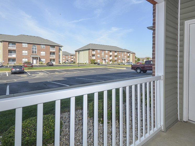 Exterior Patio Overlooking the Grass and Parking