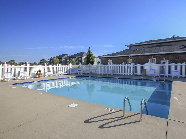 Pool and Sundeck with Lounge Chairs