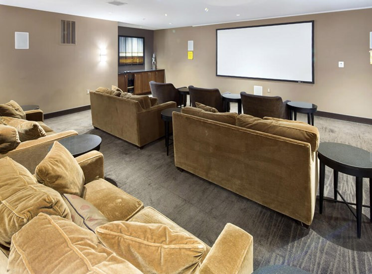 Media room with projection screen  at Dwell Vienna Metro Apartments in Fairfax, VA