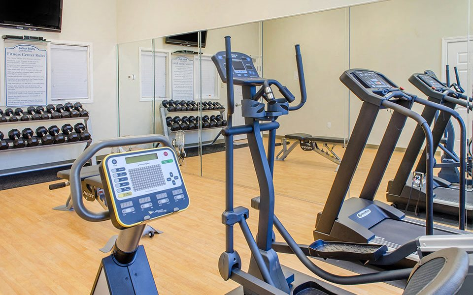 fitness center cardio equipment and weights