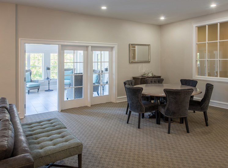 View of clubhouse dining area with French doors leading to bright, airy sun-room at Amberleigh apartments in Fairfax, Virginia 22031