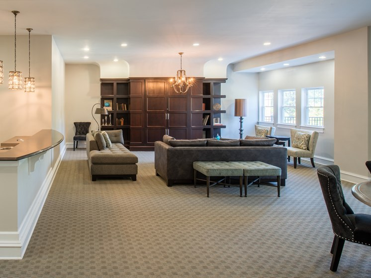 Resident clubhouse with lounge area and kitchen area with breakfast bar at Amberleigh apartments in Fairfax, Virginia 22031