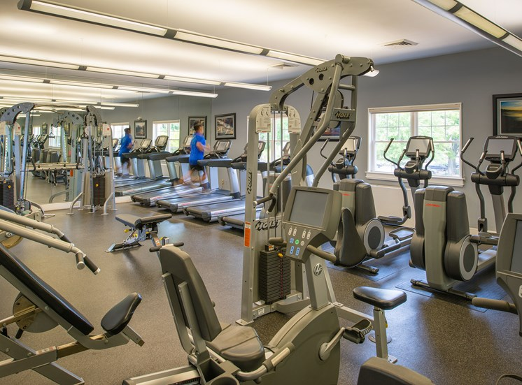 Fitness center with cardio and strength training machines at Amberleigh apartments in Fairfax, Virginia 22031
