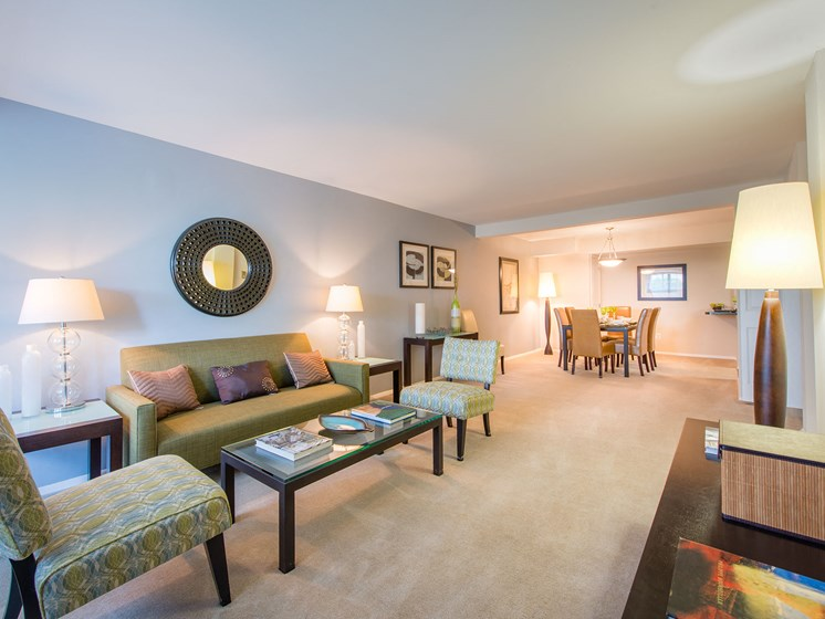 Open concept floor plan of living room area with carpeting at Amberleigh apartments in Fairfax, Virginia 22031
