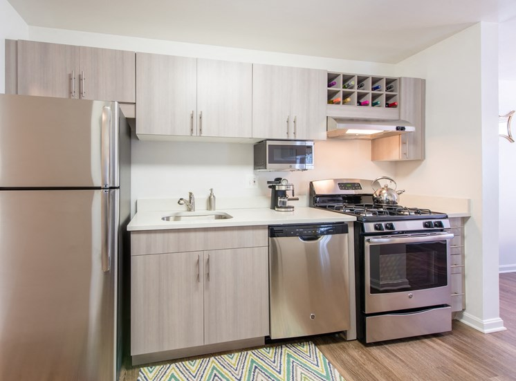Upgraded fully-equipped kitchen with stainless steel appliances and wood flooring at Amberleigh apartments in Fairfax, Virginia 22031