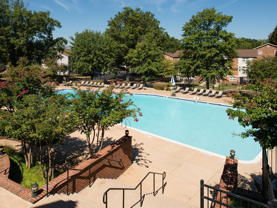 View Of Swimming Pool And Sundeck Area At Amberleigh Apartments In Fairfax Virginia 22031