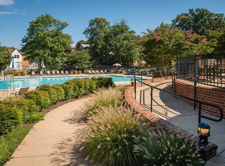 Pathway leading to swimming pool and sundeck area at Amberleigh apartments in Fairfax, Virginia 22031