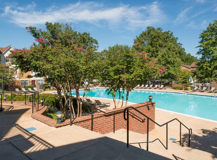 View of stairs leading down to swimming pool at Amberleigh apartments in Fairfax, Virginia 22031