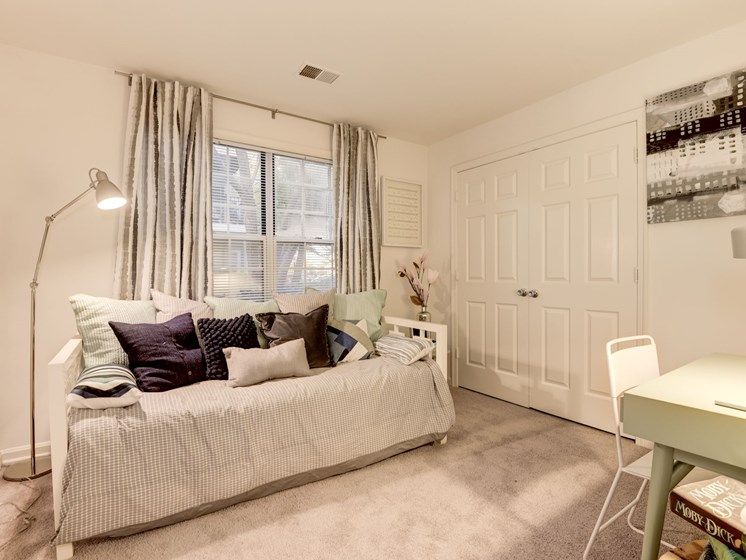 Spacious bedroom with large closet, carpeting, and window, at The Edgemoore apartments in Alexandria, VA 22315