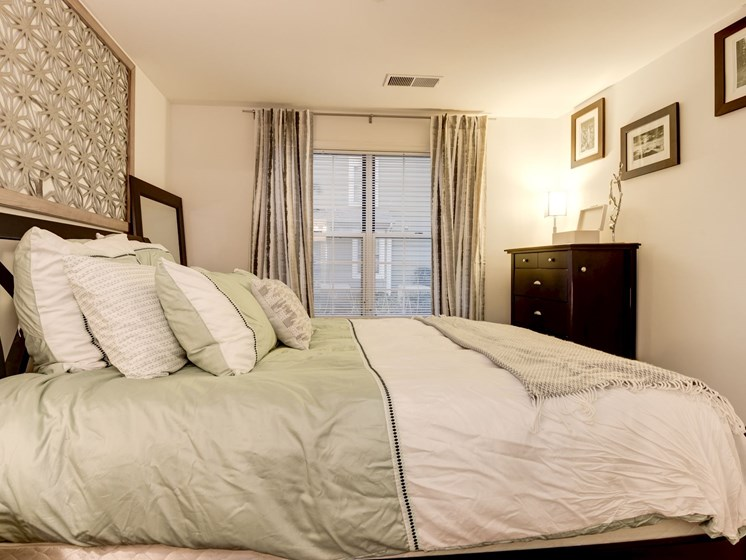 Large bedroom with carpeting and window at The Edgemoore apartments in Alexandria, Virginia 22315