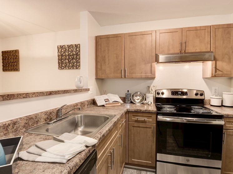 Upgraded kitchen with stainless steel appliances and new cabinetry at The Edgemoore apartments in Alexandria, VA 22315