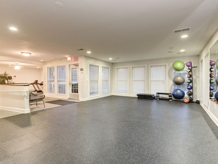 Large Fitness Room with Yoga Studio, at The Edgemoore apartments in Alexandria, VA 22315