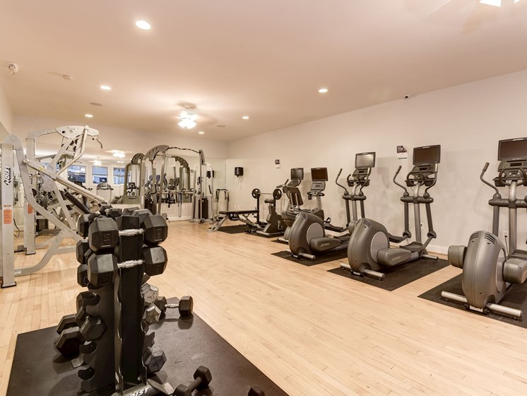 Fitness Center with cardio and strength training machines and free weights, at The Edgemoore apartments in Alexandria, VA 22315