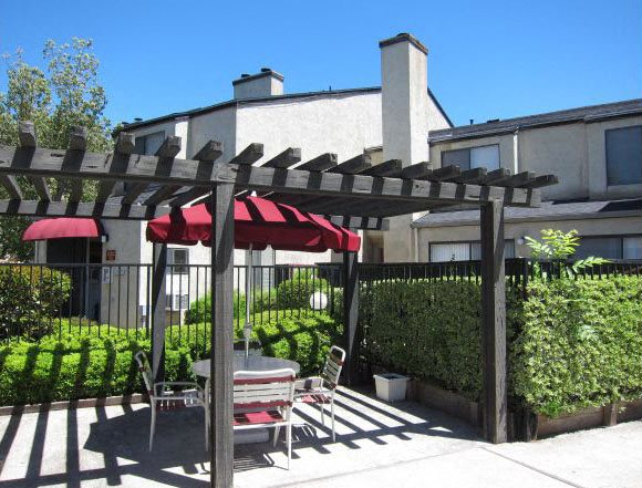 Quailwood Apartments | Stockton, CA 95207 | Covered Poolside Tables