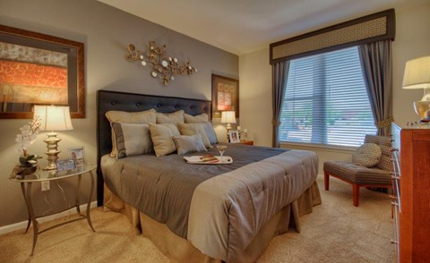 Vue Park West bedroom with king sized bed and wall to wall carpet