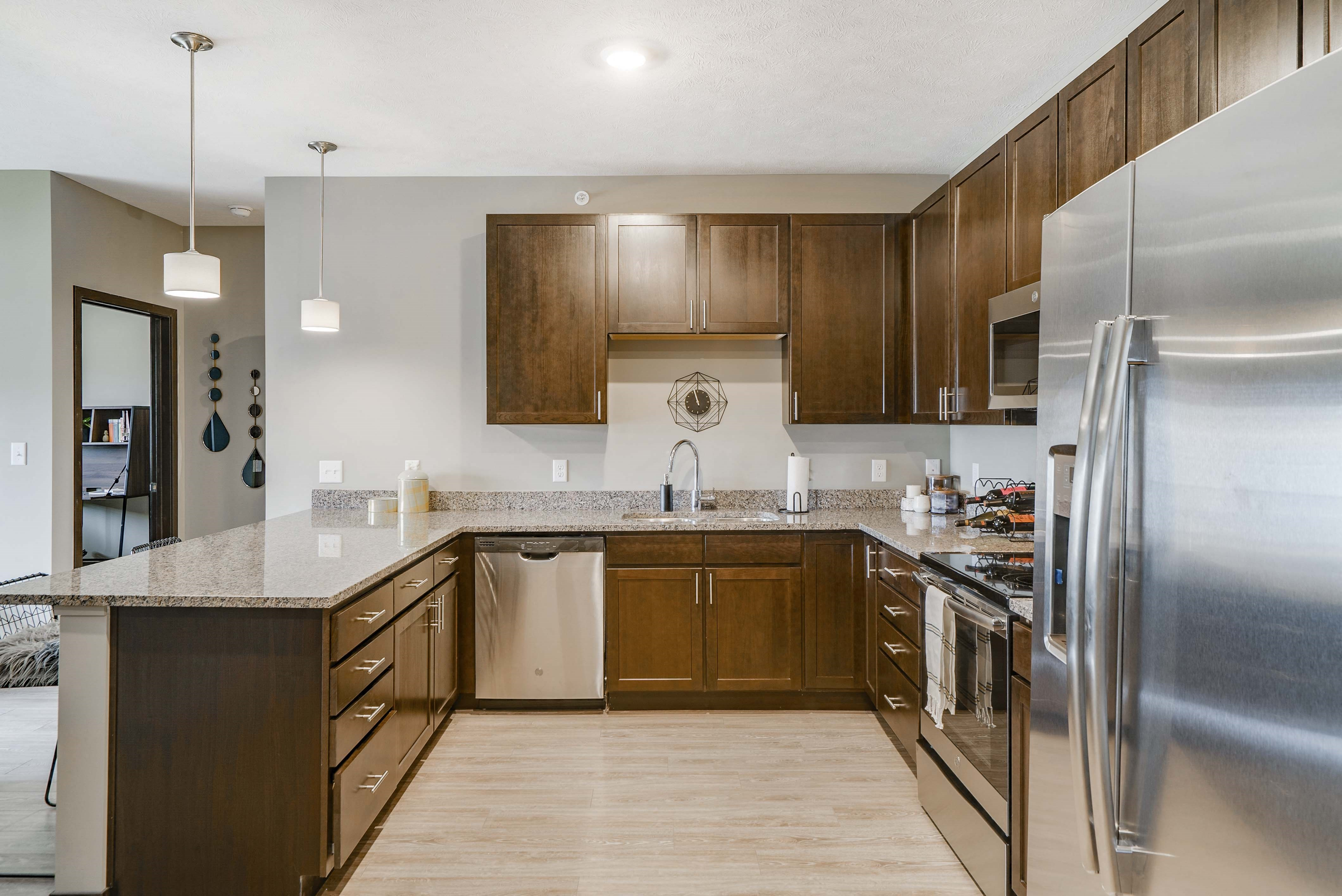 Spacious kitchens with granite countertops at WH Flats new luxury apartments in south Lincoln NE 68516