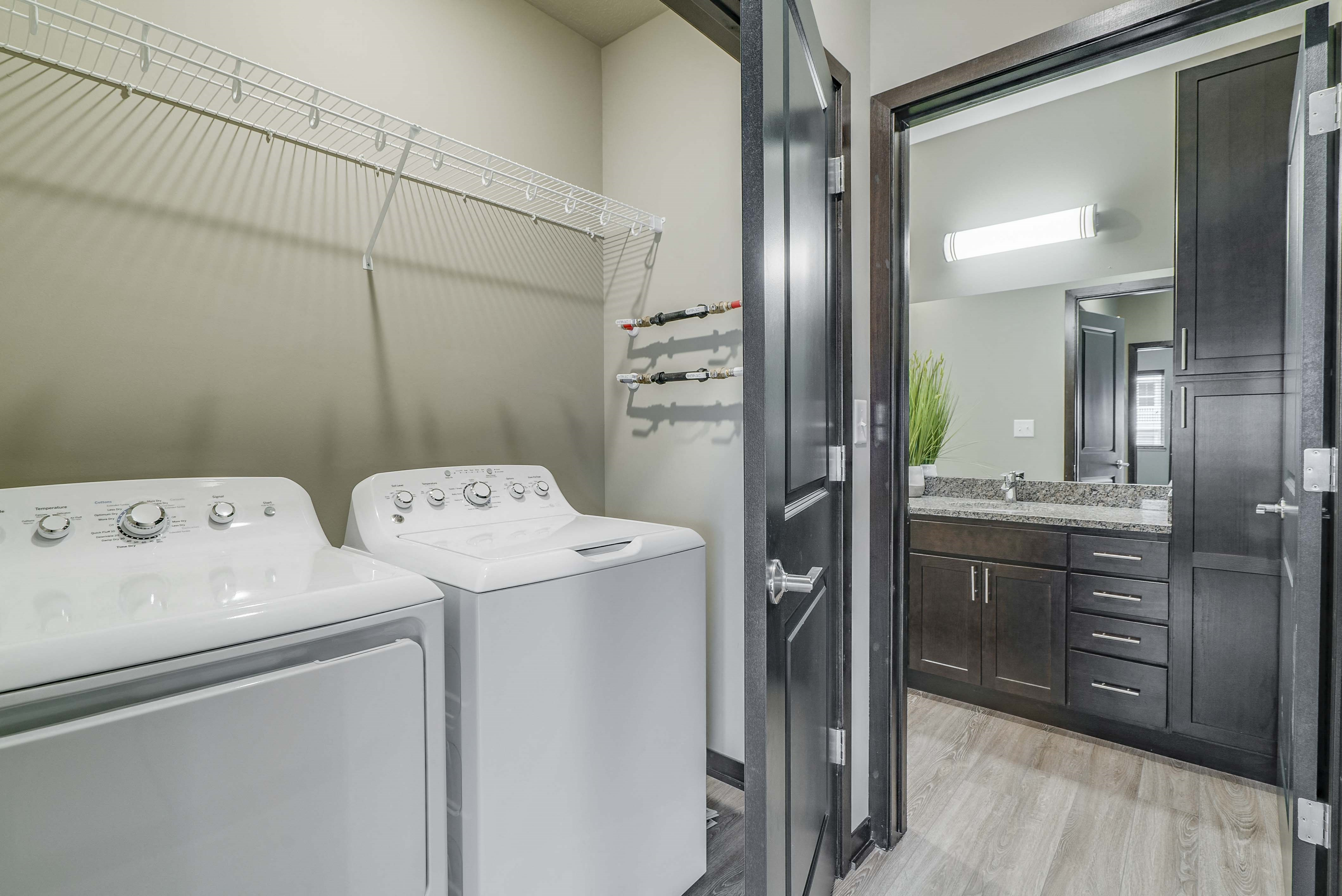 Laundry area and spacious bathroom at WH Flats new luxury apartments in south Lincoln NE 68516