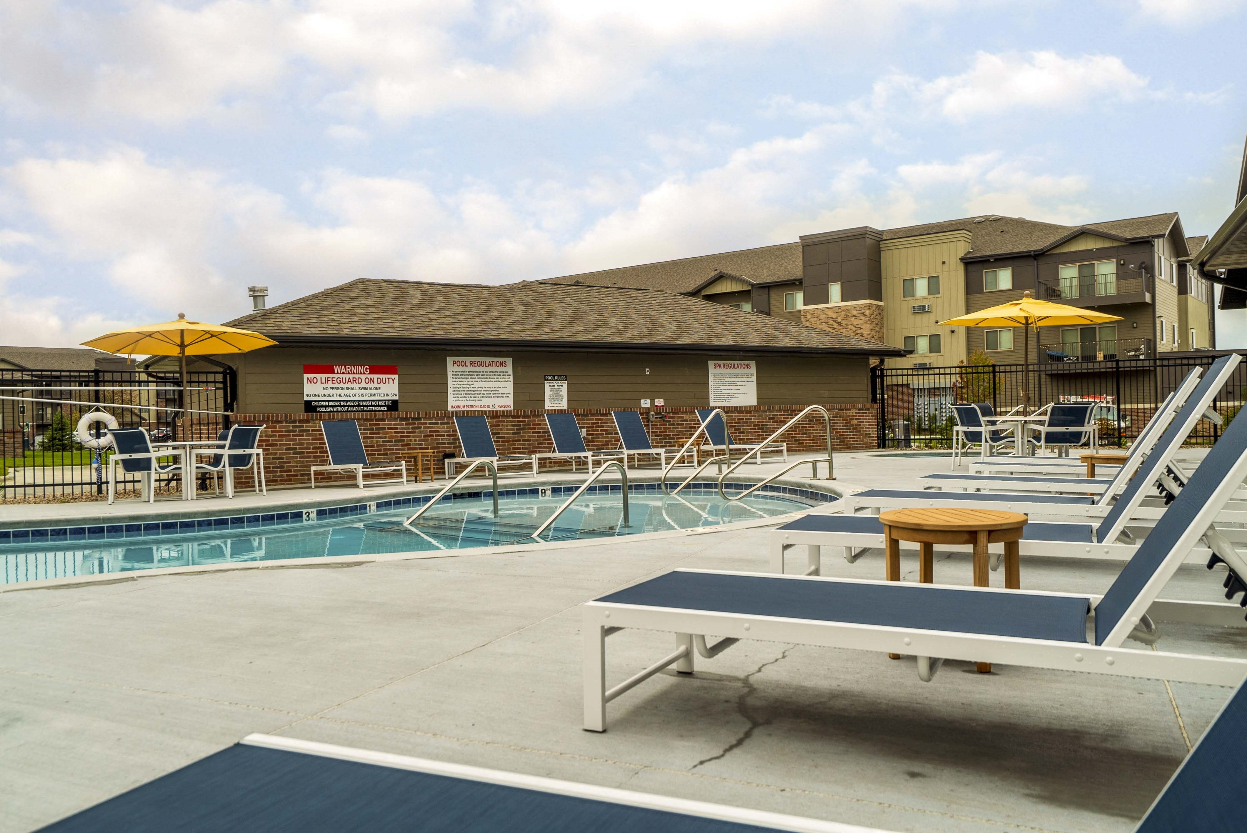 Exteriors - Luxury pool and hot tub view of WH Flats new luxury apartments in south Lincoln NE 68516