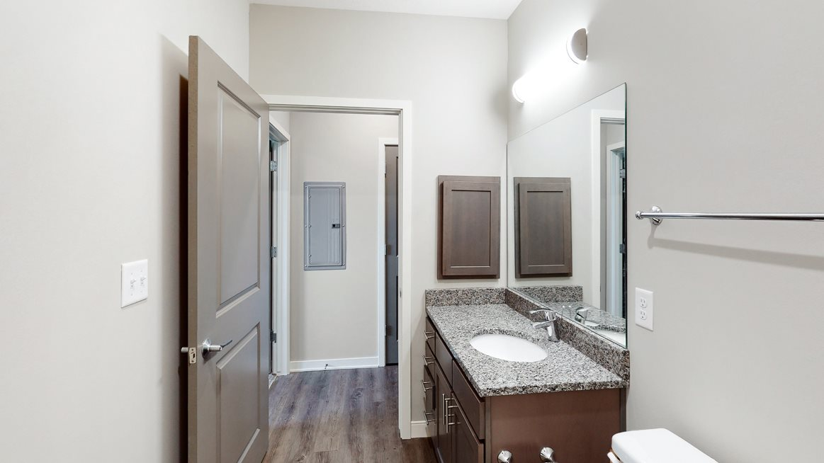 The 2 bedroom Marigold with den floor plan features 2 spacious bathrooms with granite vanity top and abundant storage.