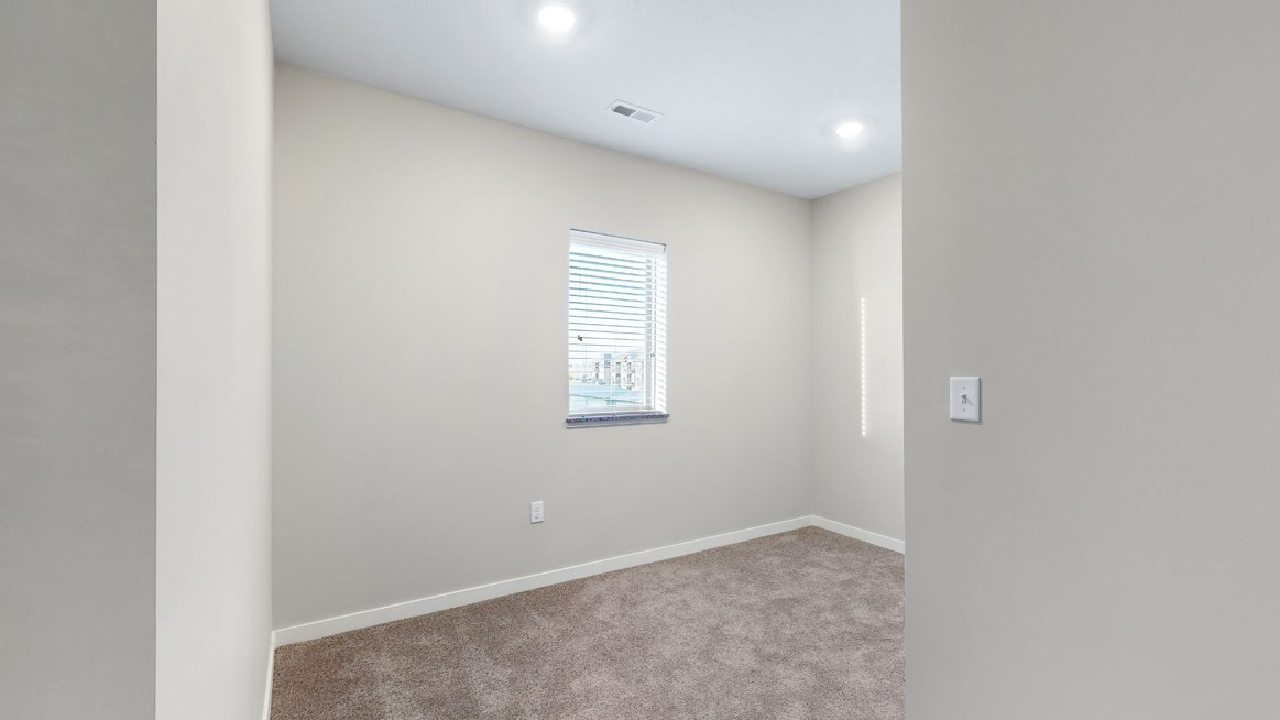 The den area in the 2 bedroom Marigold with den floor plan is perfect for a desk or reading nook.
