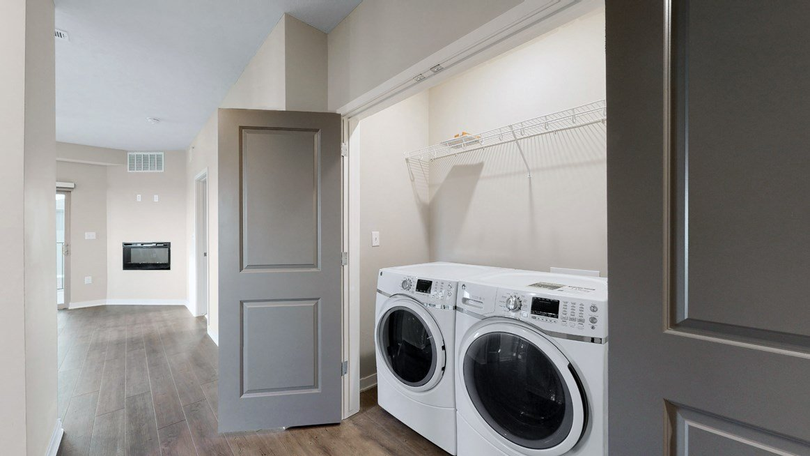 A washer and dryer are included in the 2 bedroom Marigold with den floor plan at WH Flats