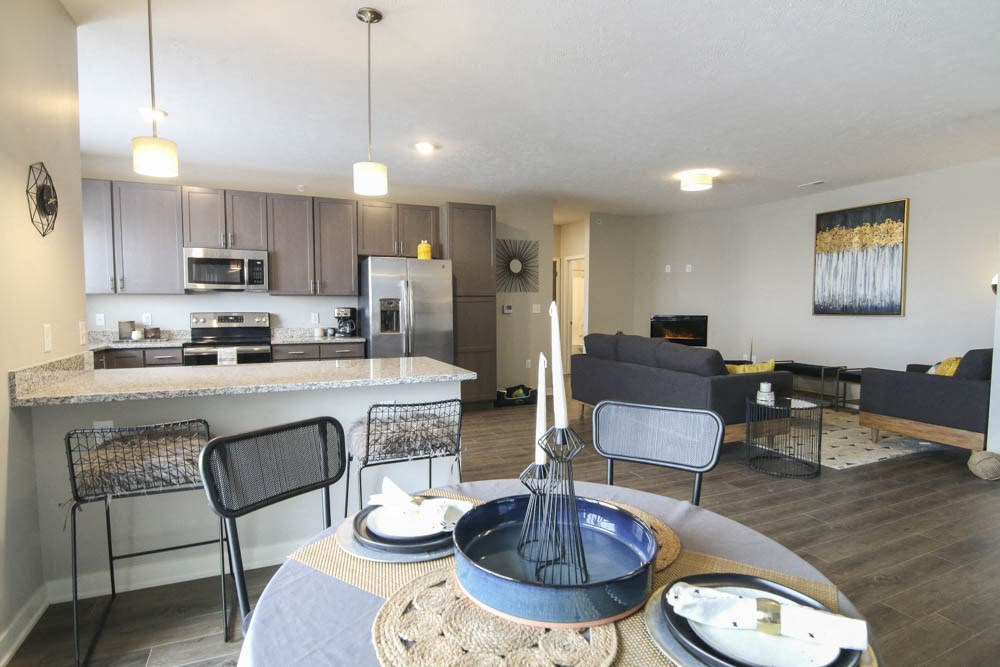 View of kitchen and living room from dining area at WH Flats new luxury apartments in south Lincoln NE 68516