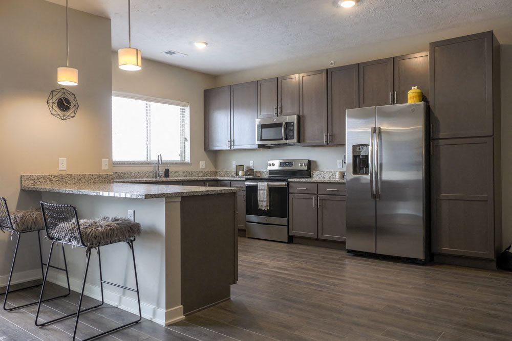 Large kitchen with stainless-steel appliances and peninsula at WH Flats new luxury apartments in south Lincoln NE 68516