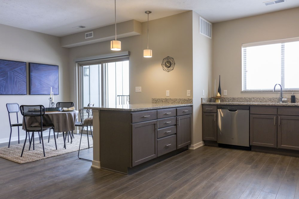 View of dining room from kitchen at WH Flats new luxury apartments in south Lincoln NE 68516