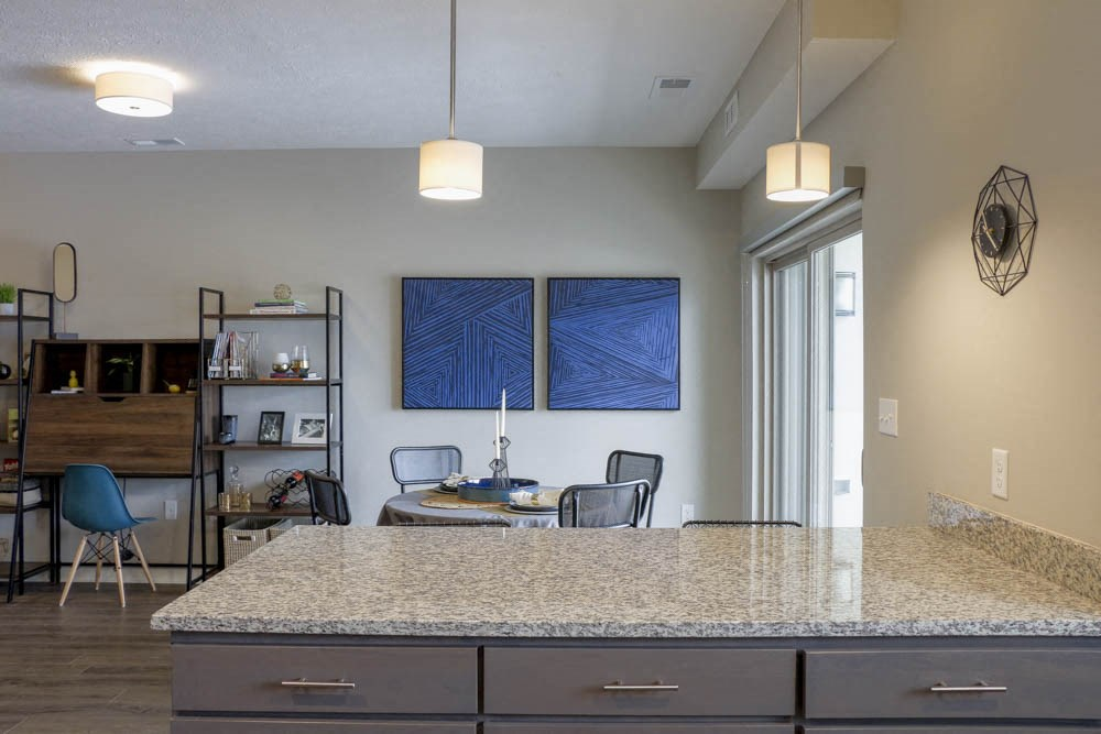 Kitchen peninsula with sophisticated pendant lights at WH Flats new luxury apartments in south Lincoln NE 68516
