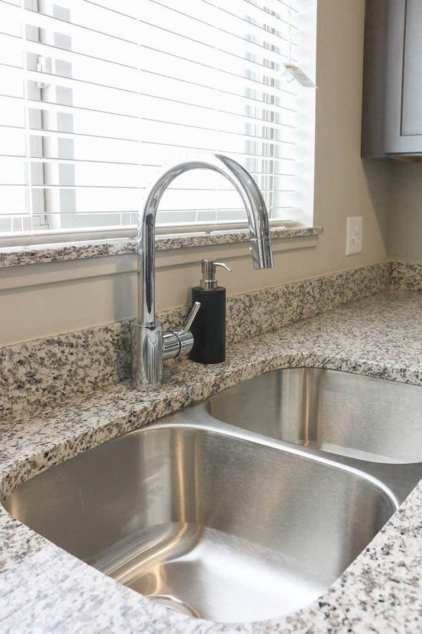 Grohe-brand faucet in kitchen at WH Flats new luxury apartments in south Lincoln NE 68516