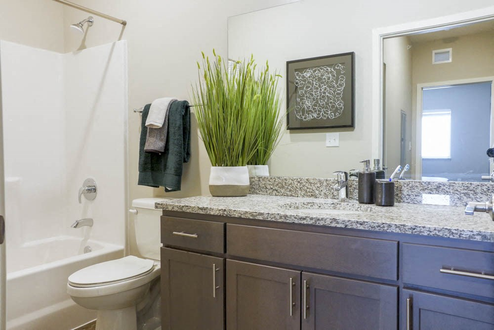 Bathroom with granite countertops at WH Flats new luxury apartments in south Lincoln NE 68516