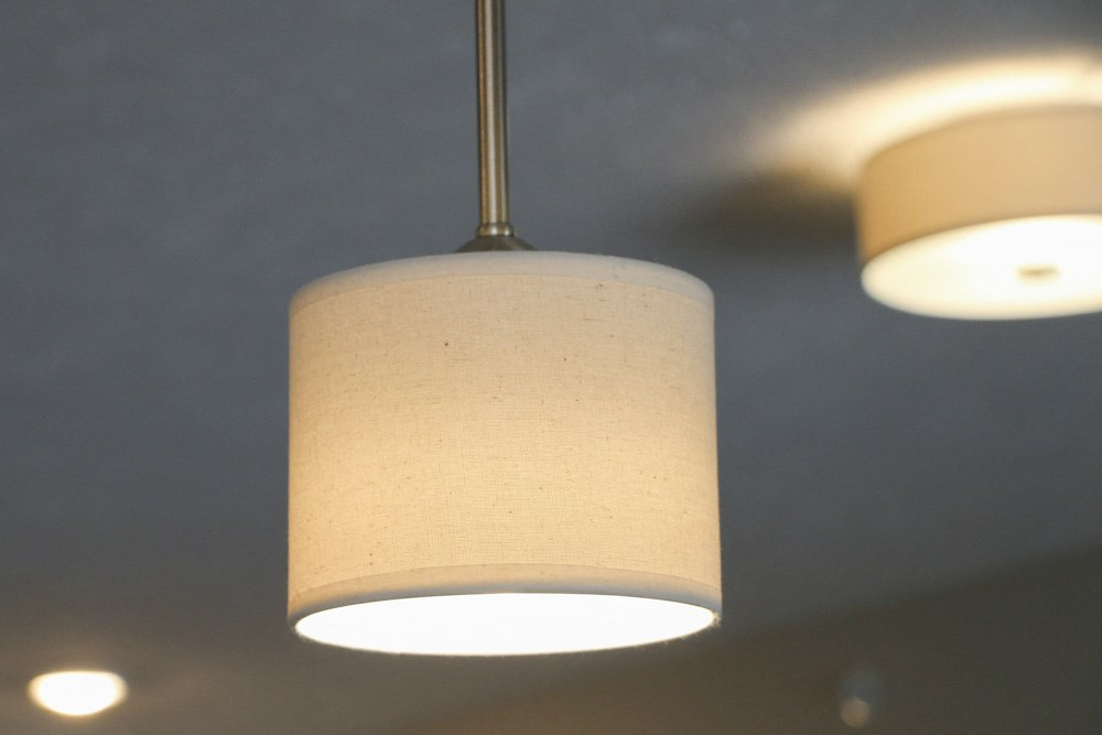 Pendant light over kitchen peninsula at WH Flats new luxury apartments in south Lincoln NE 68516