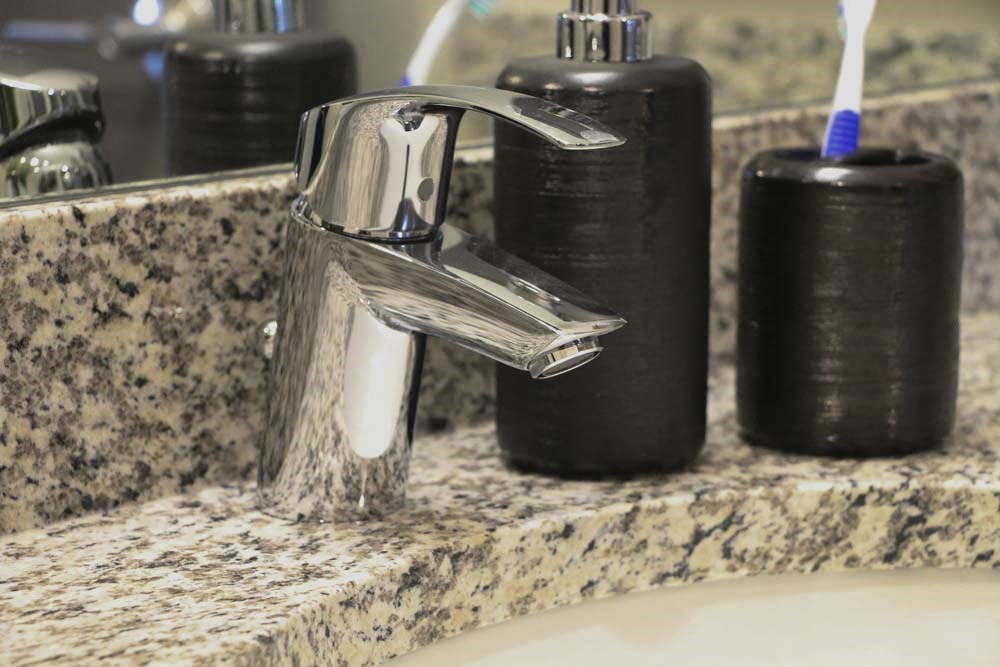 Designer faucet in bathroom at WH Flats new luxury apartments in south Lincoln NE 68516