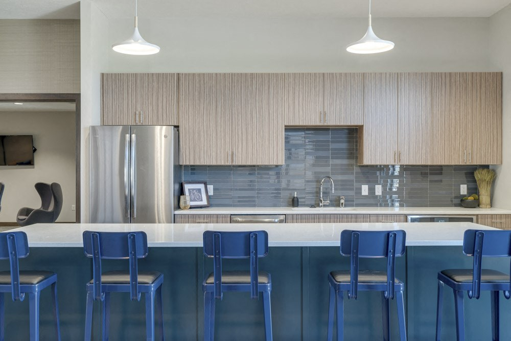 Modern blue chairs at clubhouse kitchen at WH Flats luxury apartments in south Lincoln NE