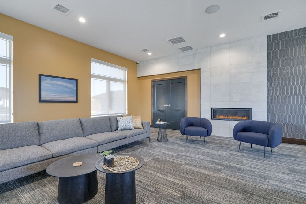 Resident lounge with fireplace and seating at WH Flats luxury apartments in south Lincoln NE