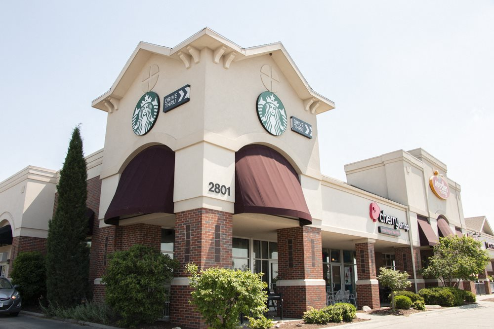 Exterior view of Starbucks near WH Flats new luxury apartments in south Lincoln NE 68516