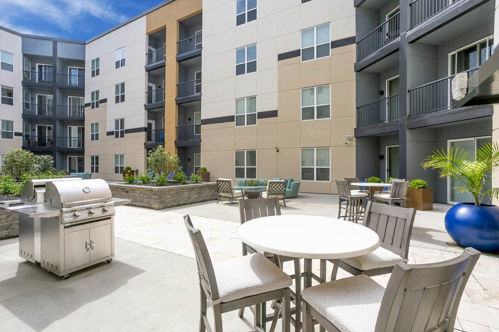Bright enclosed patio with grills and patio seating