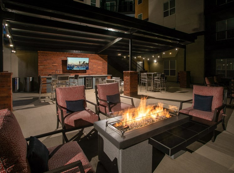 Relaxing outdoor community space with modern fireplace and outdoor televisions