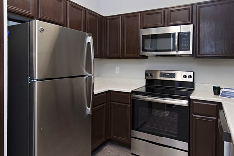 kitchen with brown cabinets and stainless steel appliances