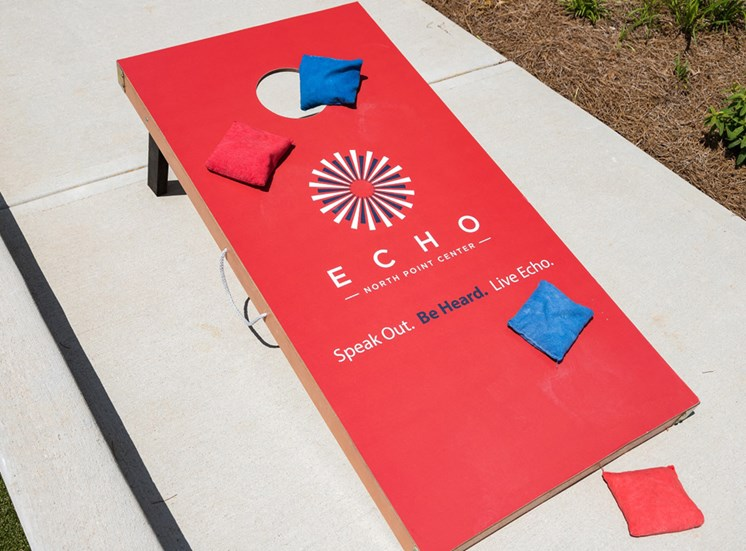 Enjoy a Game of Corn Hole with Friends at Echo at North Pointe Center Apartment Homes, Alpharetta, GA 30009