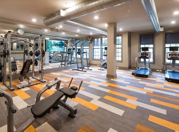 Fitness Center with Cardio, CrossFit & Yoga Components at Echo at North Pointe Center Apartment Homes, Alpharetta, GA 30009