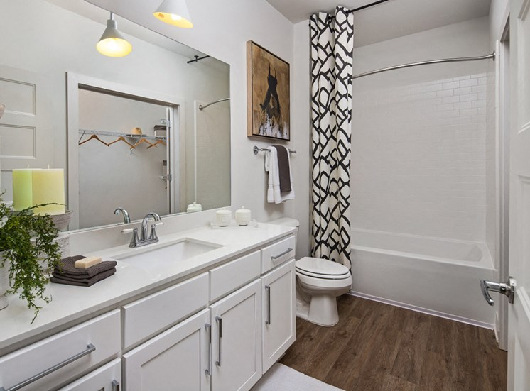 Relax in your Stunning Bathroom with Double Vanity Sinks, Subway Tile Showers with Glass Enclosures and Full Length Mirrors at Echo at North Pointe Center Apartment Homes, Alpharetta, GA 30009