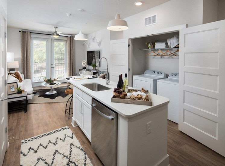 Open-Concept Kitchens with Quartz Countertops and Classic Shaker Cabinets at Echo at North Pointe Center Apartment Homes, Alpharetta, GA 30009
