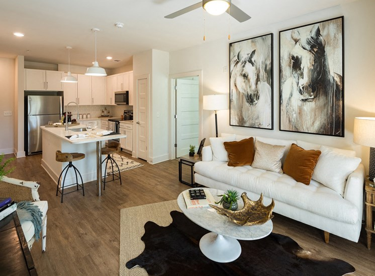 Open Floor Plans with Plenty of Living Space featuring Barn-Style Lighting and Reclaimed Wood-Inspired Flooring at Echo at North Pointe Center Apartment Homes, Alpharetta, GA 30009