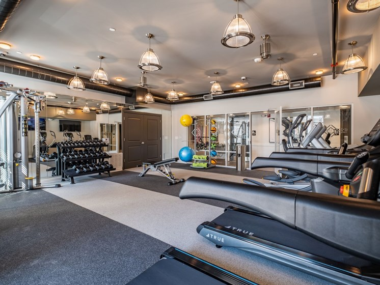 Fitness Center With Updated Equipment at Abberly CenterPointe Apartment Homes by HHHunt, Virginia, 23114