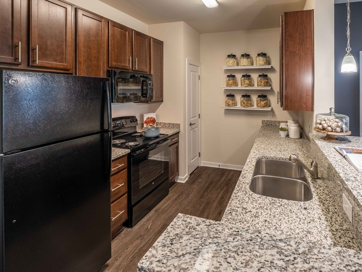 Granite Counter Tops In Kitchen at Abberly CenterPointe Apartment Homes by HHHunt, Midlothian, VA, 23114