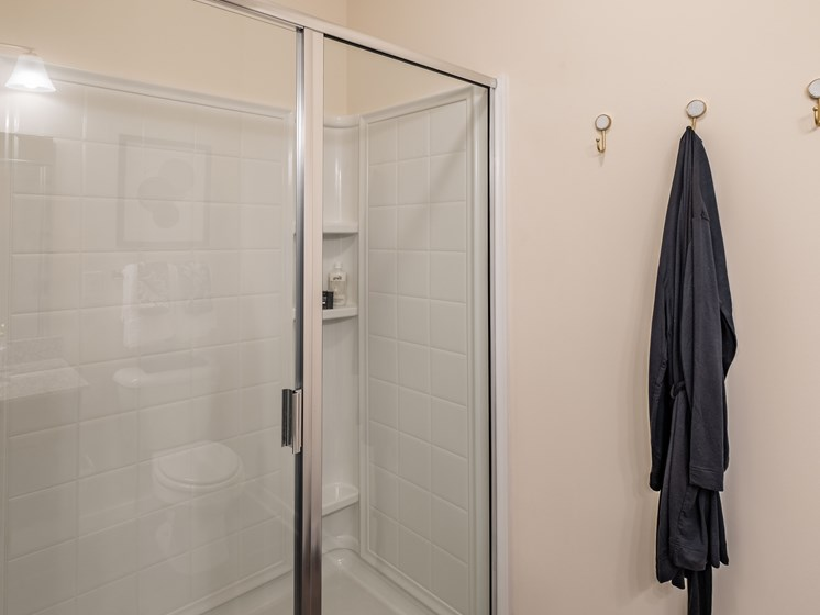 Oval Tub With Combo Shower at Abberly CenterPointe Apartment Homes by HHHunt, Virginia