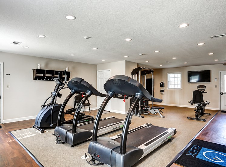 Fitness Center at Archer's Pointe with treadmills, an elliptical, and stationary bike.